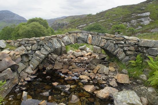 Ancient Arched Stone Bridge across Mountain Stream--Photographic Print