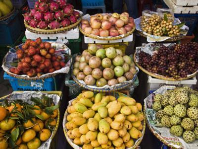 Display of Tropical Fresh Fruit in Market, Including Rambutans, Mangoes, Longans and Dragon Fruit