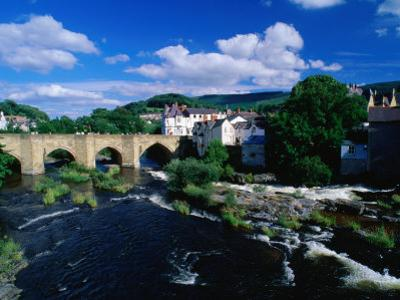 River Dee Flowing Under Bridge Through Town, Llangollen, United Kingdom