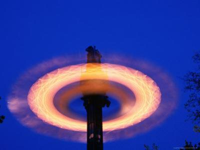 Spinning Ride in Night Sky at Tivoli Gardens, Copenhagen, Denmark