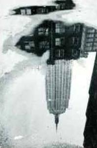 Empire State Building in a Puddle by André Kertész