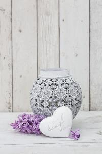 Hyacinth flowers with vase and heart shape, close up, still life by Andrea Haase