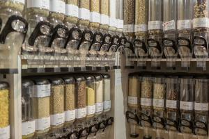 Filling container for grain in the unpackaged 'Stückgut' shop, Altona, Hamburg, Germany by Andrea Lang