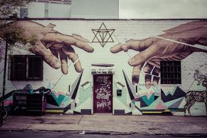 Graffiti of Michelangelo´s God and Adam´s hands in Williamsburg, Brooklyn, New York, USA by Andrea Lang