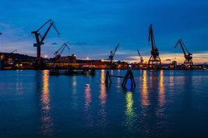 Harbour cranes at dusk, Gothenburg, province of Västra Götalands län, Swede by Andrea Lang