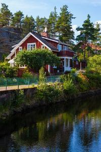 Houses at Lennartsfors by the Dalsland Canal, on Lelång Lake, Dalsland, Värmlands län, Sweden by Andrea Lang