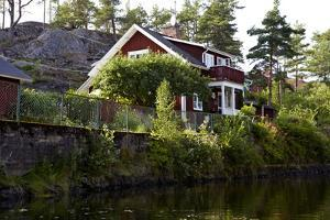 Houses with Lennartsfors in the Dalsland Canal, on Lelång Lake, Dalsland, Värmlands län, Sweden by Andrea Lang