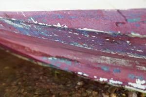 Turned canoe onshore, Sweden by Andrea Lang