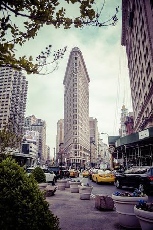 Typical NY Streetscape, busy people and traffic, Flatiron Building, Manhattan, New York, USA
