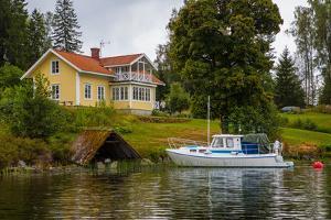Villa, boat, Gustavsfors, Lelång Lake, Dalsland, Sweden by Andrea Lang