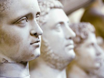 Close-Up of Statue Faces on a Shelf in the Vatican, Rome, Italy