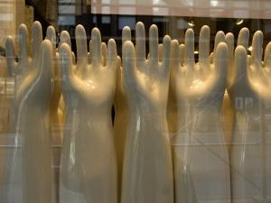 Old-Fashioned Hand Molds in a Window in New York City by Andrea Sperling