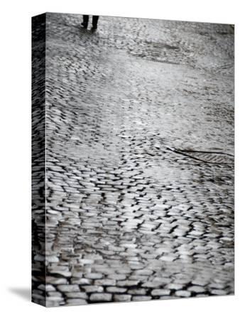 Person's Feet Walking Down Cobblestone Street in Rome, Italy