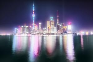 Foggy yet colorful skyline of Shanghai Pudong at night, Shanghai, China, Asia by Andreas Brandl