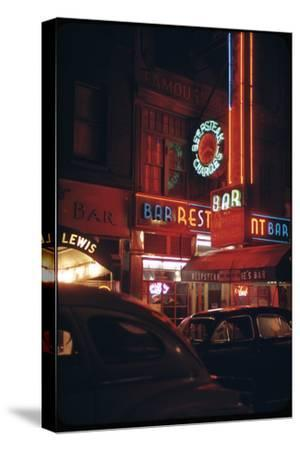 1945: a Night Image of Beef Steak Charlie's Restaurant on 50th and Broadway, New York, NY