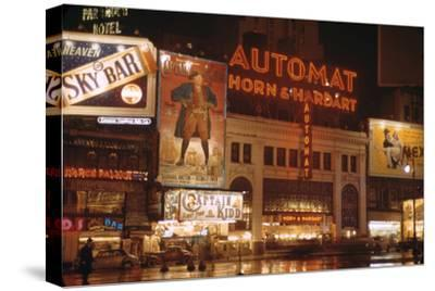 1945: Broadway and 42nd Street at Night in Front of Automat Horn and Hardart, New York, NY