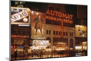 1945: Broadway and 42nd Street at Night in Front of Automat Horn and Hardart, New York, NY by Andreas Feininger