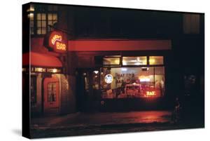 1945: Harry's Bar' Lit Up at Night, 52nd Street, Midtown Area, New York, Ny by Andreas Feininger