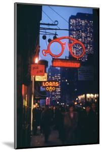1945: Midtown Manhattan at Night with Neon Lights Advertising, New York, Ny by Andreas Feininger