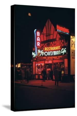 1945: Neon Lights Outside the Sportsman Cafe on 236 West 50th Street at Night, New York, NY