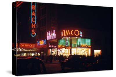1945: Signs for the Orbach Department Store and Simko Shoe Store in the Union Square, New York, Ny