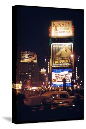 1945: Times Square at Night with Traffic and Lit Billboards, New York, Ny