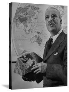 American Engineer and Architect Buckminster Fuller Holding a Globe by Andreas Feininger