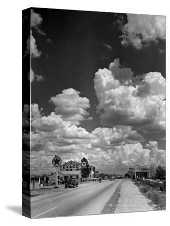 Cumulus Clouds Billowing over Texaco Gas Station along a Stretch of Highway US 66