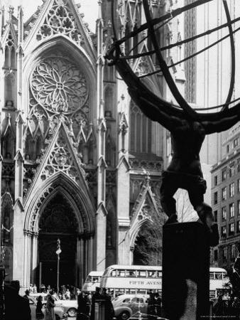 Entrance to St. Patrick's Visible Across Fifth Avenue, with Atlas Statue Silhouetted in Foreground by Andreas Feininger