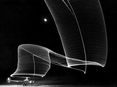 Light Pattern in the Moonlight Sky Produced by Time Exposure of Light by Andreas Feininger