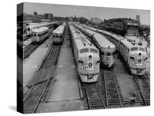 """Men are Loading Up the """"Santa Fe"""" Train with Supplies before They Take-Off by Andreas Feininger"""