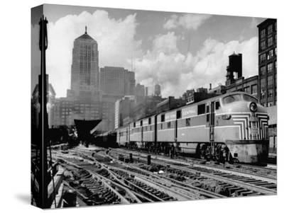 New York Central Passenger Train with a Streamlined Locomotive Leaving Chicago Station