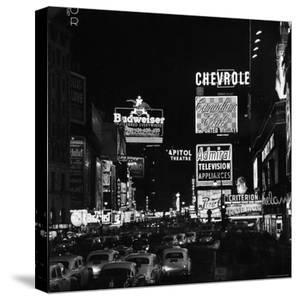 Night View of Taxi and Traffic Congestion Looking North on 45th Street by Andreas Feininger