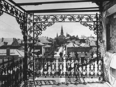 Orleans Street, Center of Old French Quarter of City, Through Grillwork of a Balcony by Andreas Feininger
