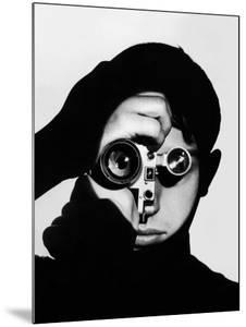 Photographer Dennis Stock Holding Camera to His Face by Andreas Feininger