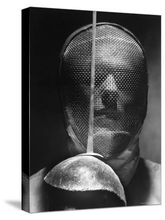 Portrait of Fencer Wearing Sabre Mask