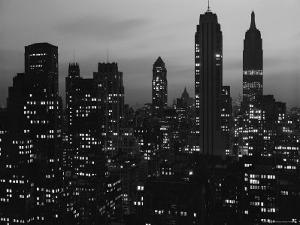 Silhouette of the Empire State Building and Other Buildings without Light During Wartime by Andreas Feininger