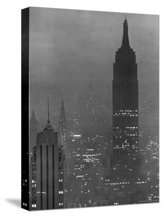 Silhouette of the Empire State Building and Other Buildings without Light During Wartime