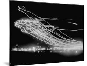 The Pattern Made by Landing Lights of Planes in 20 Minute Time Exposure at La Guardia Airport by Andreas Feininger