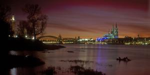 Germany, North Rhine-Westphalia, Cologne, View from the Deutz Shore over the Rhine after Sunset by Andreas Keil