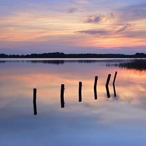 Germany, Mecklenburg-Western Pomerania, Mecklenburg-Vorpommern, Sundown in the Schaalsee by Andreas Vitting