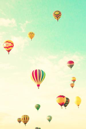 Colorful Hot Air Balloons in a Green Mint Summer Sky