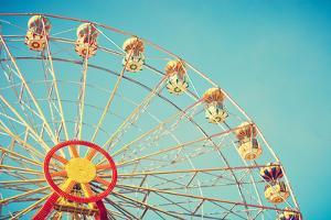 Vintage Colorful Ferris Wheel over Blue Sky by Andrekart Photography