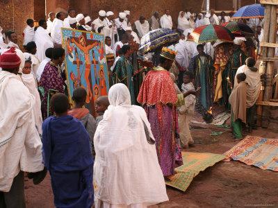 Ethiopian Orthodox Priest Leads Procession Around Church of Bet Maryam During Fasika