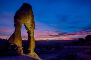 Delicate Arch at sunset in Arches National Park. by Andrew Coleman