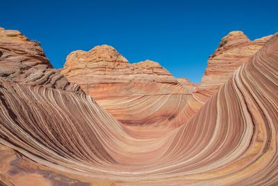 The Wave under a blue day sky in North Coyote Buttes.