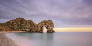 Dusk descends at Durdle Door on the Jurassic Coast, UNESCO World Heritage Site, Dorset, England, Un by Andrew Sproule