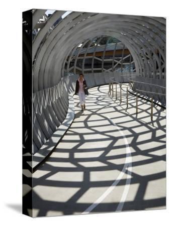 Australia, Victoria, Melbourne, Docklands; Pedestrian Crossing the Webb Dock Bridge