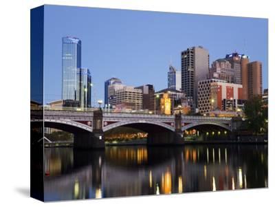 Australia, Victoria, Melbourne; Princes Bridge on the Yarra River, with the City Skyline at Dusk