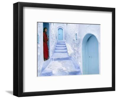 Local Woman Steps Out into Whitewashed Streets of Rif Mountains Town of Chefchaouen, Morocco